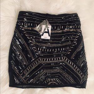 ANGL Black mini skirt